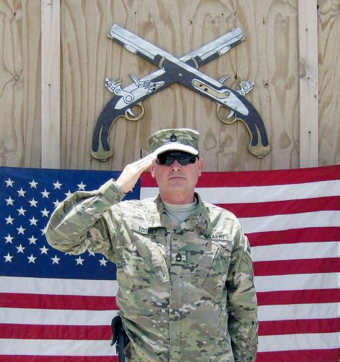 Dagsboro Police Chief Floyd Toomey salutes while stationed in Afghanistan. Toomey will be retiring from the force and become the constable at Phillip C. Showell Elementary School in Selbyville.