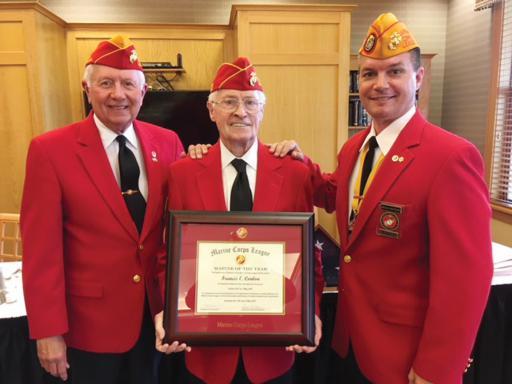 Frank Conlan, center, stands with Department of Delaware Commandant Chuck Landon and National Vice Commandant Bruce Rakfeldt.