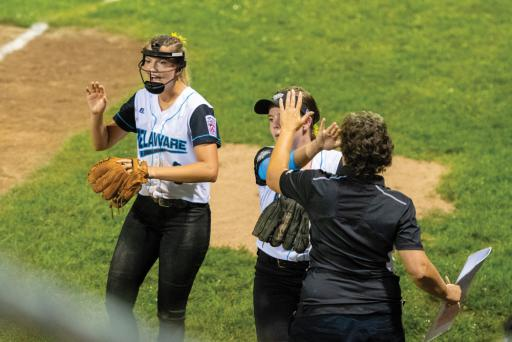 District 3's Taylor Wroten and Jordan DiFava give high-fives after Wroten struck out another East batter during Game 1 of the Senior League Softball World Series on Monday night.