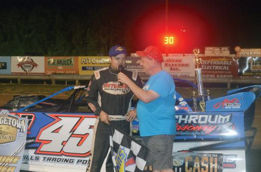 Clash for Cash winner Jamie Lathroum speaks to an announcer after winning the event on Friday, June 28, at the Georgetown Speedway.