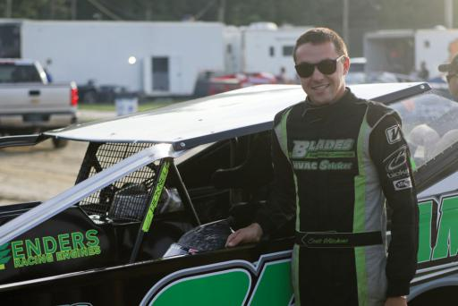 Scott Hitchens poses with his Blades HVAC Services car at Georgetown Speedway last year.