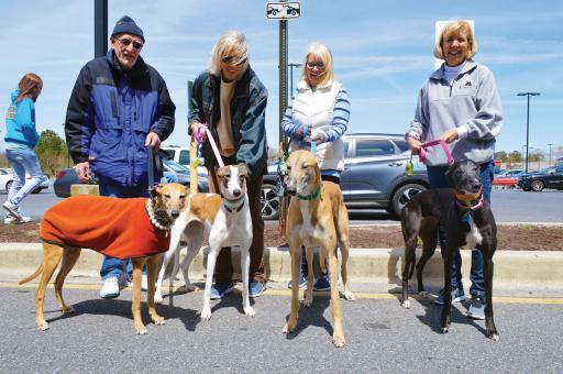 From left, Rosie with owner Ron Wohlust, BB with Sandi Roberts, Logan with Helen Delvecchio and Lucy with Mary Buckley.