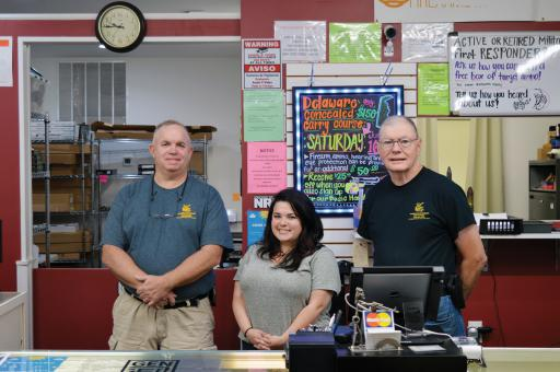 Don Dempsey, Meghan Dempsey and Roger Perry pose for a photo at Gunshooters in Millsboro.