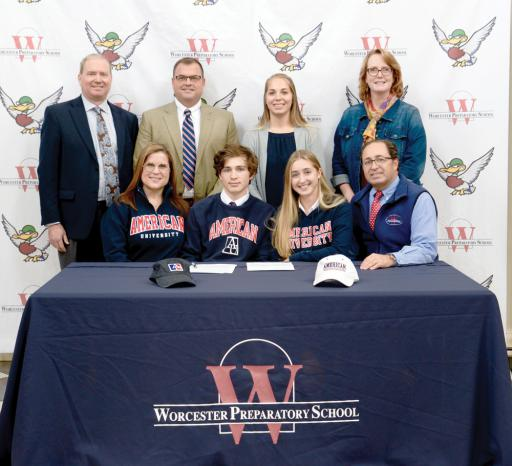 Celebrating Worcester Prep senior Hailee Arrington's committing to the American University field hockey team are, from left: seated, her mother, Suzanne Arrington, younger brother John Arrington (WPS Class of 2021), Arrington, her father, Jason Arrington; and, standing, WPS Head of School Randal Brown, WPS Director of Athletics Matt McGinnis, WPS Varsity Field Hockey Coach Katie Oxenreider and WPS Director of College Counseling Vickie Garner.