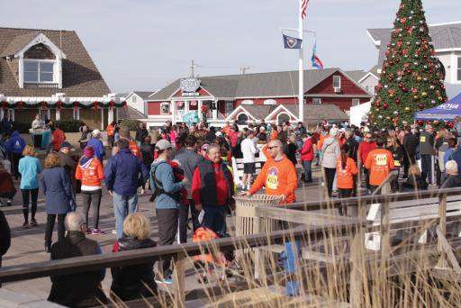 Volunteers, participants and spectators all gathered on the boardwalk for the 2016 Hair of the Dog 5K run/walk and 10K run.