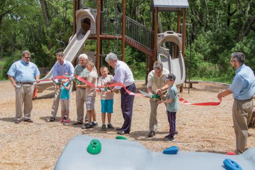 Local and state officials were on hand at the Holts Landing State Park ribbon-cutting event, celebrating the park's improvements over the last year.