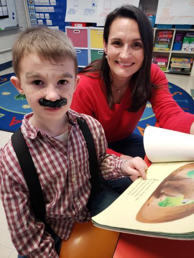 Kindergarten student Griffin Deane, 5, reads with Amanda Miller, reading specialist at Lord Baltimore Elementary School, in observance of February being I Love to Read Month.