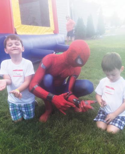 Spider-Man shows off his web shooters to his new buddies, Shane and Sean.