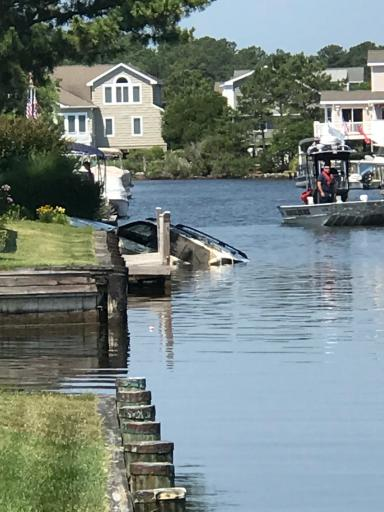 Bravo's vehicle being pulled from a South Bethany canal.