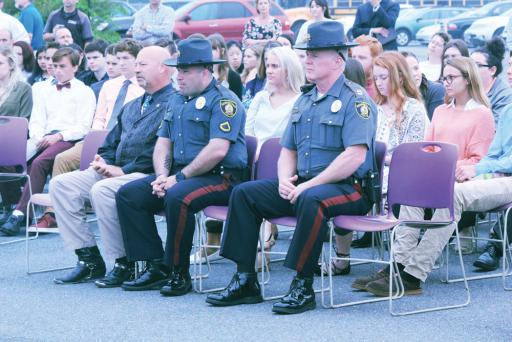 Members of law-enforcement join Delmarva Christian High School for an outdoor SYATP Chapel Service.