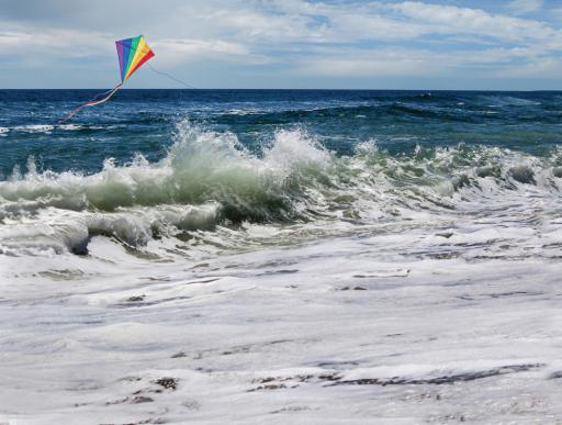 One of Maureen Ickrath's photos depicts a kite flying over a crashing wave.