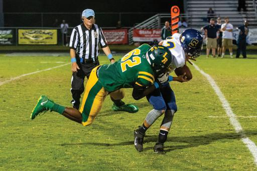 Indian River's JaQuan Floyd makes a tackle in IR's win over Seaford on Friday, Sept. 27.