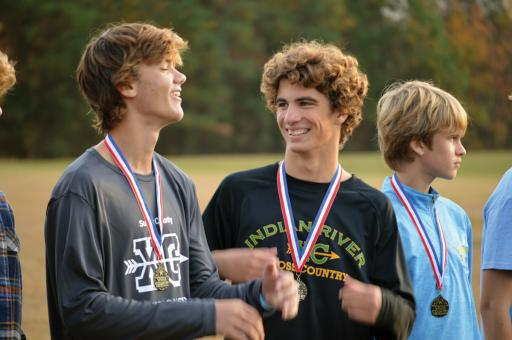 Indian River juniors R.J. Senseny, left, and Declan Burke are all smiles after receiving their medals following their Top 10 finishes in the 2019 Sussex County Cross Country Championship meet on Tuesday, Oct. 29, at Sussex Academy.