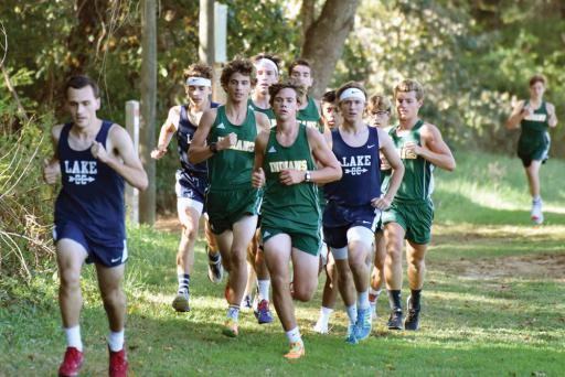 The boys run through a wooded portion of the course at Killens Pond State Park.