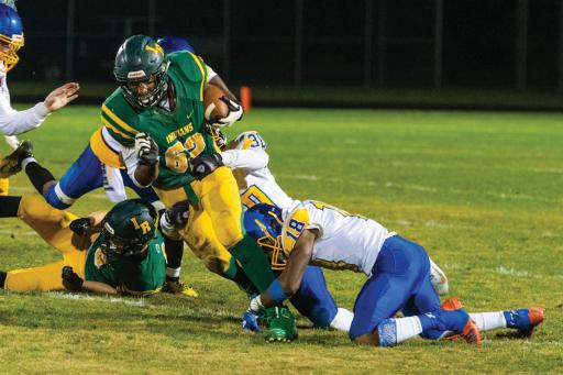 Indian River's JaQuan Floyd powers through a leg tackle in IR's loss to Sussex Central on Thursday, Nov. 7.