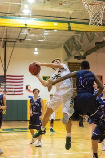 IR's Mason Miccizhe goes up strong during a game last year.