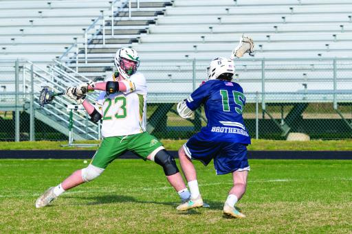 Indian River's Zachary Schultz takes a shot in IR's 8-10 loss against Gunston School on Friday, March 29.