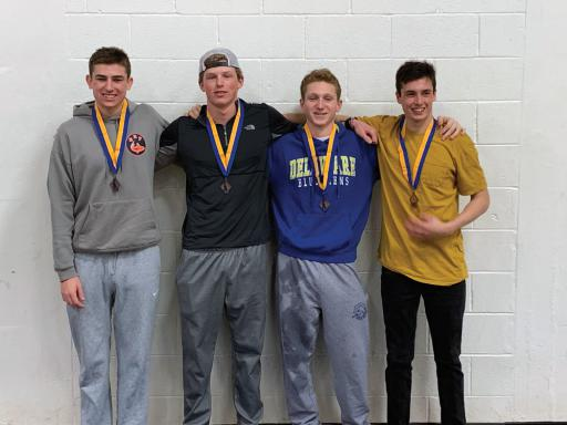 Michael Barnes, Mitch McGee, Will Douds and Max Kohr pose for a photo after taking third overall in the 200 freestyle-relay at the state championships at UD.