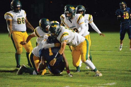Indian River's defense picks up a sack in the Indians' win over Seaford on Friday, Oct. 12.
