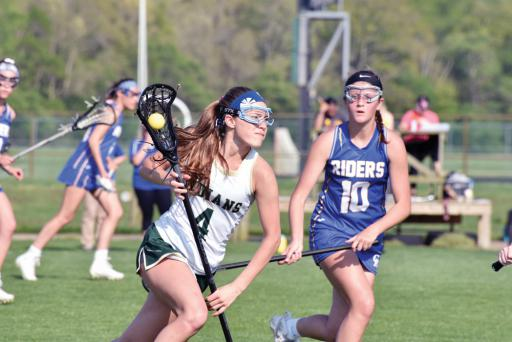 An IR player maneuvers through Caesar Rodney's defense during a game on Tuesday, April 30.