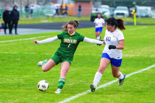 IR's Anastasia Diakos holds her ground while trying to get a pass off during IR's win over Sussex Central last week.