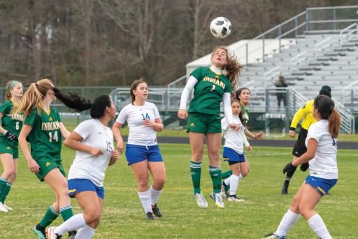 Anastasia Diakos goes for a header in Indian River's 5-0 victory over Sussex Central on Tuesday, April 2.