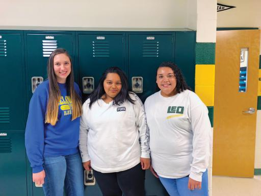 Indian River High School students and IRHS Leo club members Hannah Gentry, Ashley Morales and Hailey Hudson pose for a photo in the school.