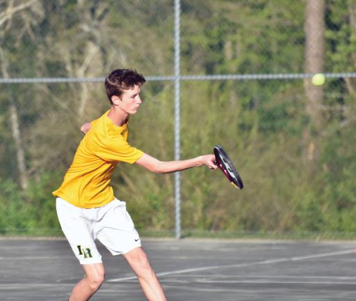 One of the Indians prepares to send a volley back over the net in IR's win over Lake Forest on Monday, April 30.