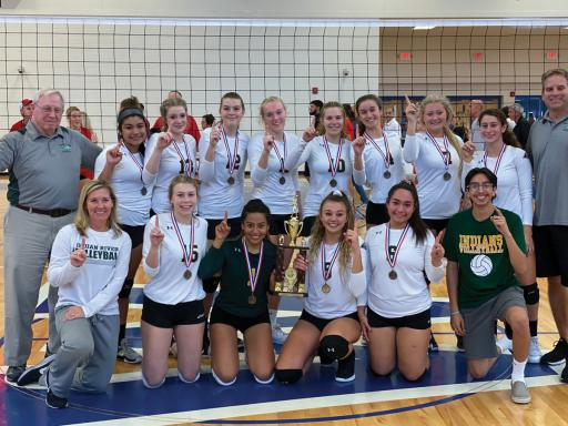 The Indian River High School girls' volleyball team poses with the Henlopen Conference championship trophy.