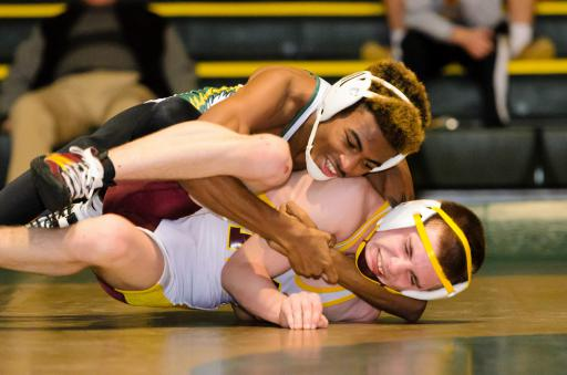Ta'Jon Knight works his opponent to his back during a match earlier this season.