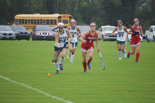 Indian River's Kayler Townsend (24) pushes the ball up the field as Smyrna's Julie Snow (3) gives chase.