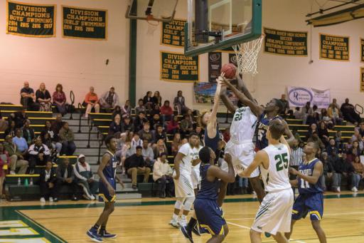 The Indians struggle to reach the basket as the Blue Jays intercept. Indian River lost to Seaford in overtime, 50-46.