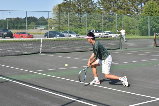An Indian River tennis player returns a volley.