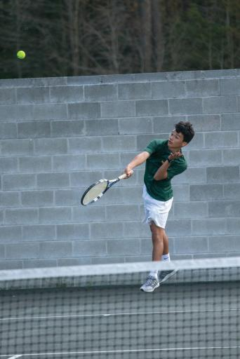 An IR tennis player volleys during a previous match.