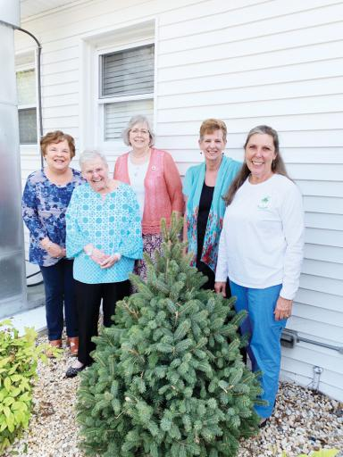 Pictured, from left, are: Recording Secretary Linda Kutay, Vice President Muriel Pfeiffer, Treasurer Shelby Weillop, Home Life Chair Cheryl Broadway and President Henrietta Belcher-Stack pose infront of the Indian River Yacht Club.