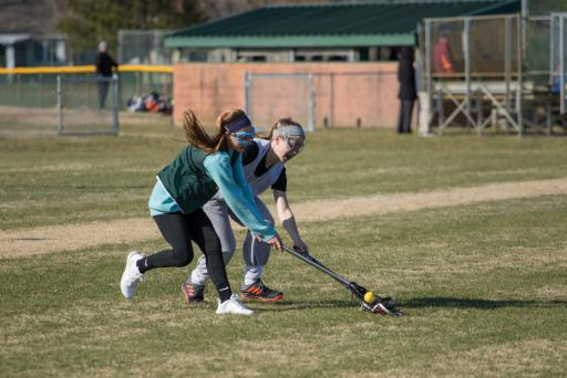 Two IRplayers fight for controll of the ball during lacrosse practice on Tuesday.