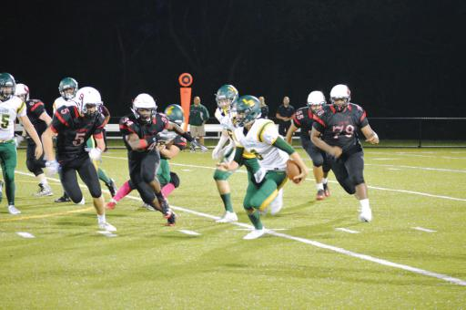 IR Quarterback Tyler Bowen looks for room to run during last Friday's game against Polytech.
