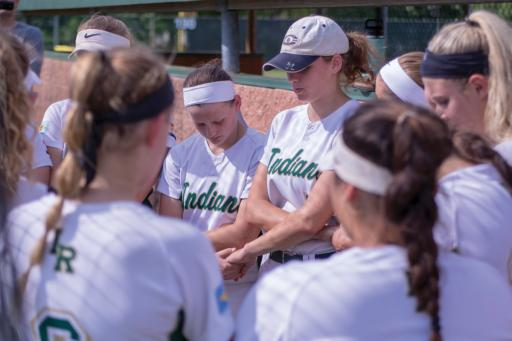Indian River's softball squad joins hands before the game, knowing the South Division title was on the line.