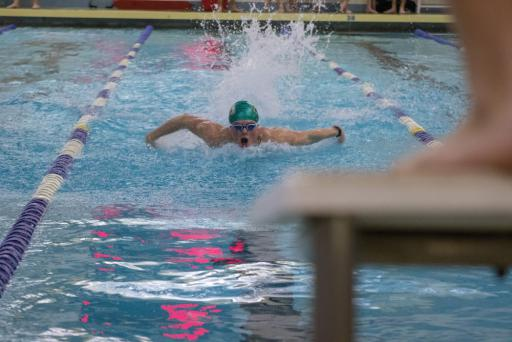An IR swimmer takes a breath during a meet earlier this swim season.