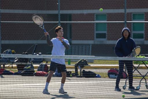 Tennis players practice on Tuesday, March 19.