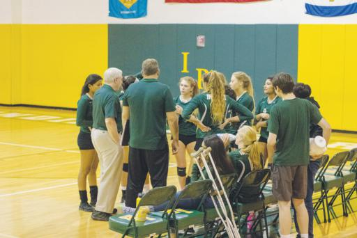 The Indian River girl's volleyball team huddles at a game during last season.