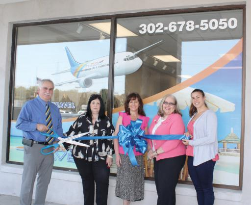 Pictured from left to right, Mithat Armutcu, Angela Armutcu, Lauren Hall, Jackie Lamothe and Sophia Sawicki pose for Jetset Travel's ribon cutting.