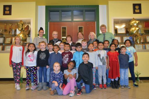 Students in Stephanie Syphard's first grade class were joined by members of the Home and Garden Club at The Refuge at Dirickson Creek on Thursday, Dec. 6 when the club presented the school with a check to be used for maintenance of the school's garden. Shown with the class are, back row from left, Principal Allisa Booth, club president Pamela White, club vice president Sandy Murphy, club secretary Nancy Scheffey, club treasurer  Ramona Bourque and Vice Principal Bennnett Murray.