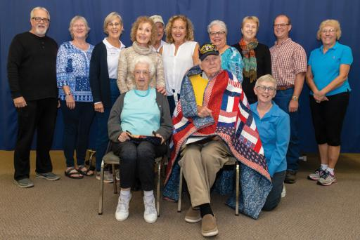 A Quilt of Valor was presented to John Roman at Aquacare Physical Therapy on Monday, Oct. 15. Pictured are: (back row) Bob Clemens, Pat Clemens, Diane Cowell, Barbara Voit, Dan Cowell, Janet Thomas, Ellen Neumann, Eric Neumann and Pat Holleran. (Front row) Jacquie and John Romanand Lenny Truitt.