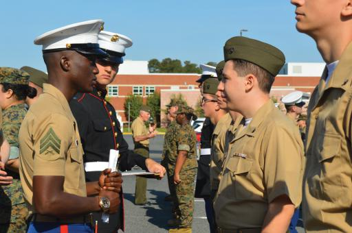 Marine Corps Sgt. Joseph Bryant, left, quizzes second-year cadet James Brett on military and U.S. history.