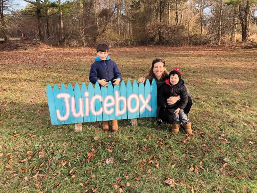 Lisa Daisey-DiFebo is flanked by her children, Luca, left, and Blaise, at the site of the new 'forever home' of Juicebox in Ocean View.