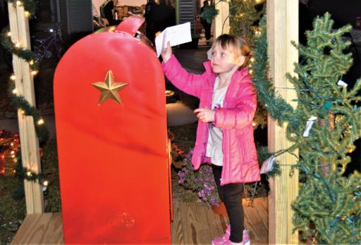 Belle DeMarie, 3, of Ocean View places her letter in the special mailbox at the Santa's Letters Neighborhood Holiday Gathering in Dagsboro on Wednesday, Dec. 12.