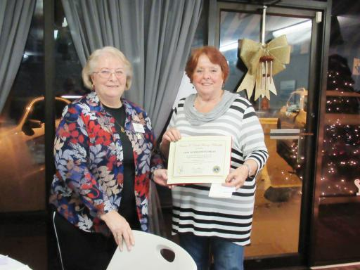 Lions President Janet Bauer presents Kathy Plumley with her award.