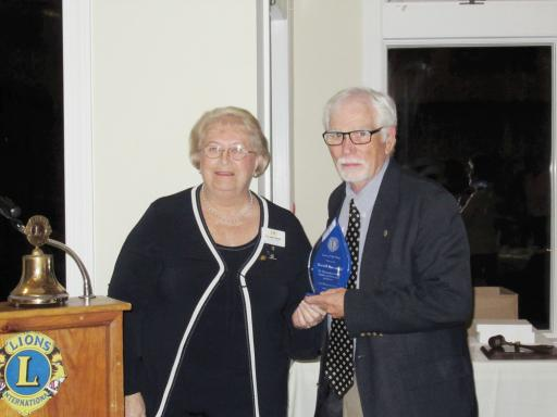 Lord Baltimore Lions Club President Janet Bauer, left, presents the Club Lion of the Year Award to Lion Don Sherwood.