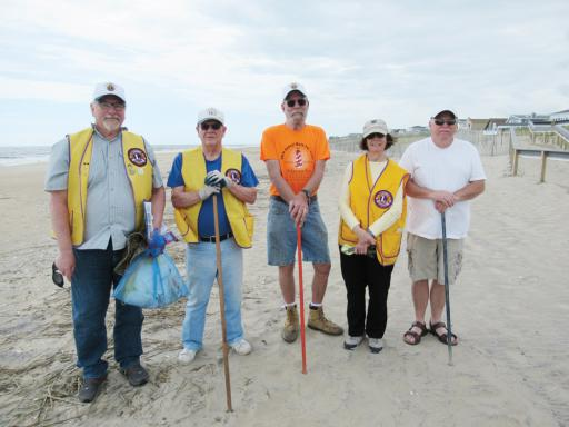 Lions pose with a bag of items collected from the LBLC Beach Clean-up of a portion of Bethany Beach. Pictured left to right, Lions Steve Straneva, Jack Bauer, Karl Gude, Pat Monahan and Paul Hammond.